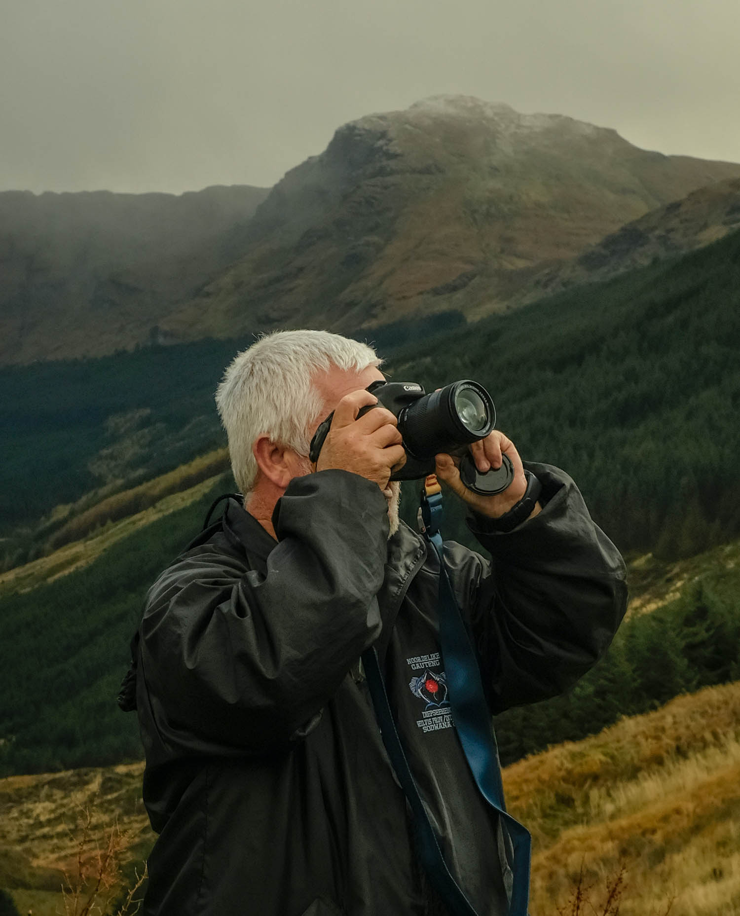 Photograph of a man taking photographs in the mountains